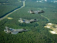 A U.S. Navy Lockheed Martin F-35C Lightning II of Strike Fighter Squadron 101 (VFA-101), a U.S. Marine Corps F-35B of Marine Fighter Attack Training Squadron 501 (VMFAT-501), and a U.S. Air Force F-35A of the 58th Fighter Squadron participate in a training sortie together, near Eglin Air Force Base, Florida.