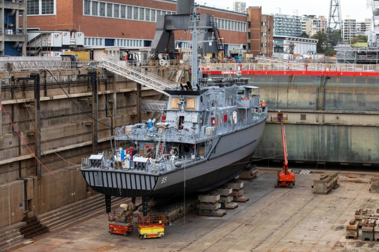 Royal Australian Navy HMAS Gascoyne undergoing refit in the Captain Cook Graving Dock at Garden Island, Sydney, following a recent deployment.