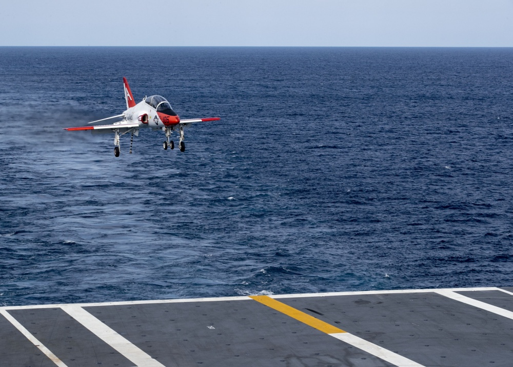 A T-45C Goshawk, attached to Training Air Wing 1, approaches to land on USS Gerald R. Ford's (CVN 78) flight deck April 7, 2020. Ford is underway in the Atlantic Ocean conducting carrier qualifications. (U.S. Navy photo by Mass Communication Specialist 2nd Class Ryan Seelbach)