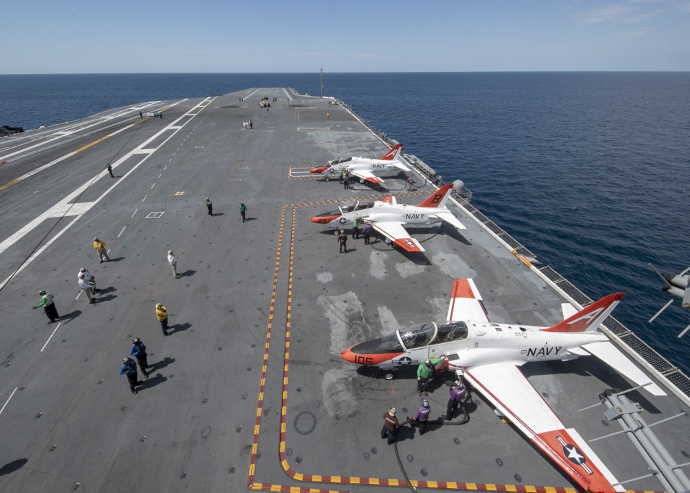 Sailors assigned to USS Gerald R. Ford's (CVN 78) air department, refuel T-45C Goshawks, attached to Training Air Wing 1 and 2, on Ford's flight deck April 7, 2020. Ford is underway in the Atlantic Ocean conducting carrier qualifications. (U.S. Navy photo by Mass Communication Specialist 2nd Class Ryan Seelbach)