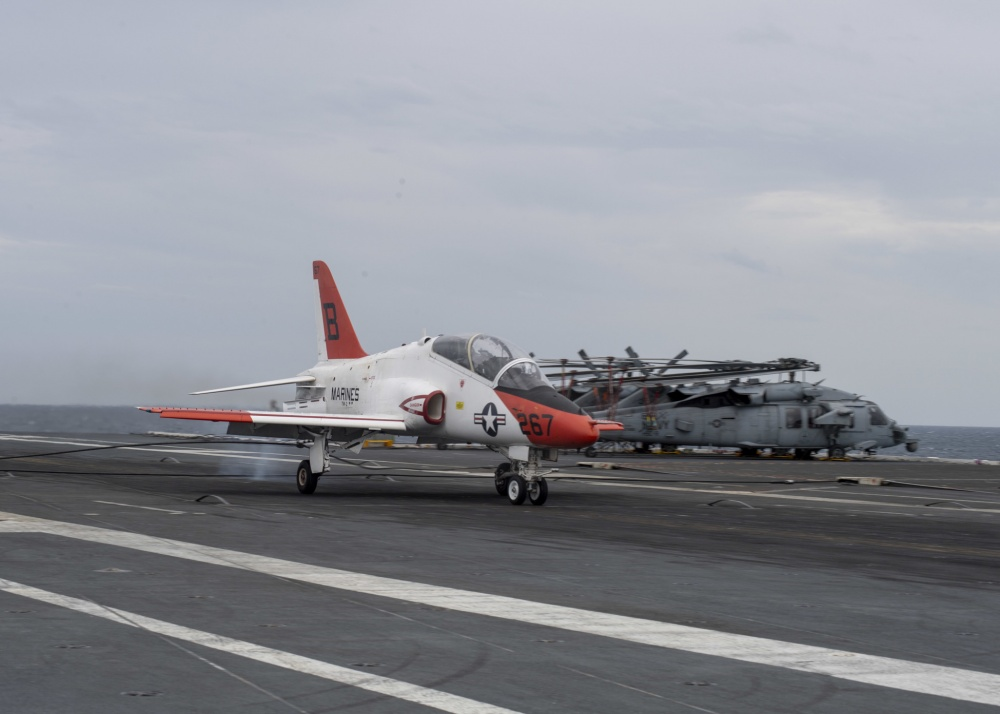 Lt. j.g. Cade Warlick lands a T-45C Goshawk, attached to Training Air Wing (TAW) 2, on USS Gerald R. Ford's (CVN 78) flight deck marking the 2,000 trap on Ford's advanced arresting gear (AAG) April 8, 2020. Ford is underway in the Atlantic Ocean conducting carrier qualifications. (U.S. Navy photo by Mass Communication Specialist Seaman Apprentice Conner Foy)