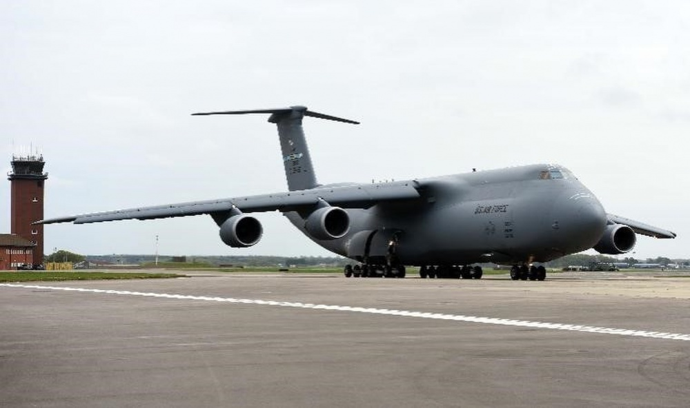 A U.S. Air Force C-5 Super Galaxy assigned to the 9th Airlift Squadron, Dover Air Force Base, Delaware, arrives at RAF Mildenhall, England, April 18, 2020. The 9th AS and the 727th Air Mobility Squadron, based at RAF Mildenhall, took part in a medical cargo mission which involved delivering COVID-19 test kits and other equipment to Accra, Ghana, to be distributed throughout the U.S. African Command area of responsibility. (U.S. Air Force photo by Senior Airman Brandon Esau)