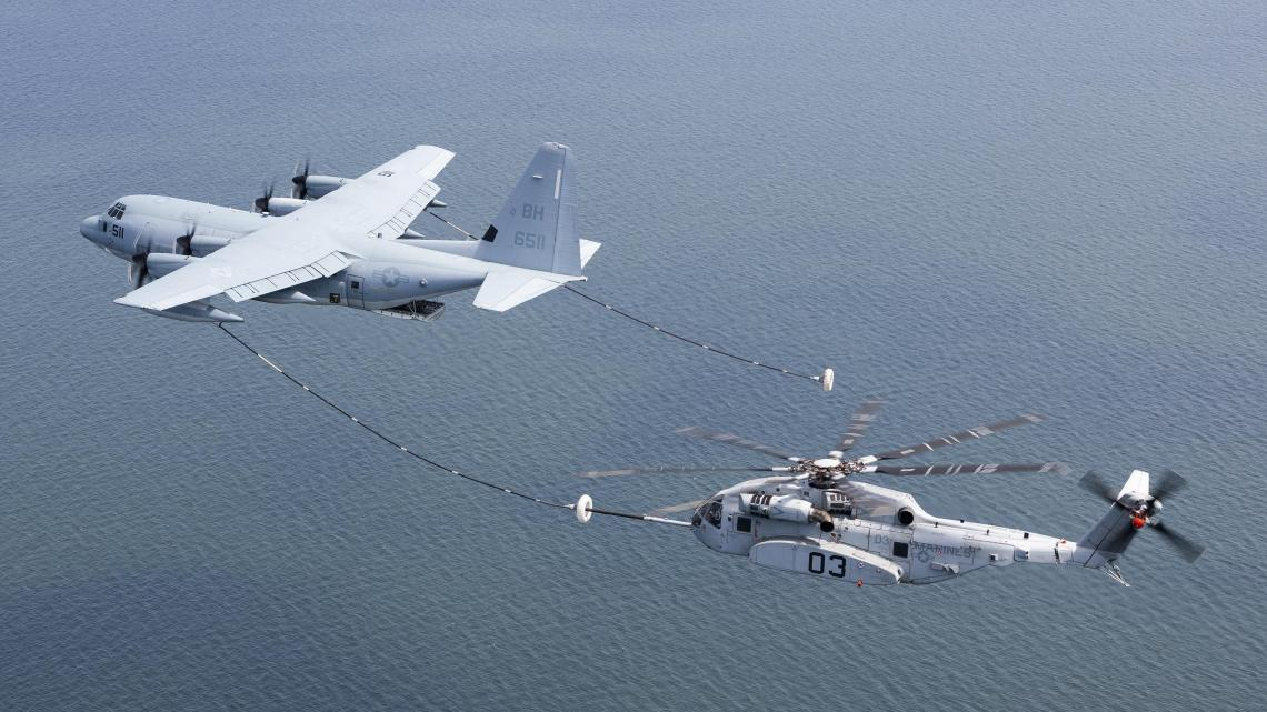 The CH-53K King Stallion successfully plugs into a funnel-shaped drogue towed behind a KC-130J during aerial refueling wake testing over the Chesapeake Bay. U.S. Navy Photo.s