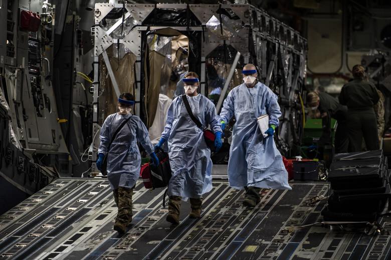 US Air Force AMC Conduct Medical Evacuation Using Transport Isolation System