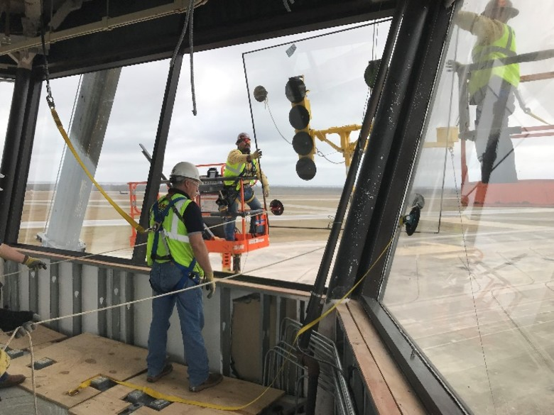In Feb. 2019, four months after Hurricane Michael devastated Tyndall Air Force Base, Fla., contractors supporting hurricane recovery efforts as part of the AFCAP IV contingency contract installed the final glass panel in the base control tower. The Air Force Contract Augmentation Program is a rapid response contract tool managed and serviced through the AFIMSC enterprise. The AFCAP V, an eight-year, $6.4 billion contingency support contract, was recently awarded to eight firms by the Air Force. (Courtesy Photo)