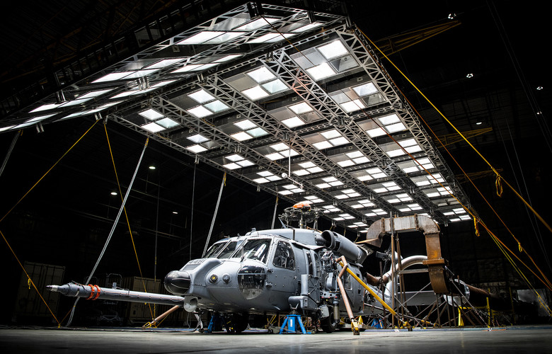 An HH-60W Jolly Green sits under bright lights used to create heat in the McKinley Climatic Lab March 19 at Eglin Air Force Base, Fla.  The Air Force's new search and rescue helicopter and crews experienced temperature extremes from 120 to -60 degrees Fahrenheit as well as torrential rain during the month of testing.  The tests evaluate how the aircraft and its instrumentation, electronics and crew fare under the extreme conditions it will face in the operational Air Force.  (U.S. Air Force photo/Samuel King Jr.)