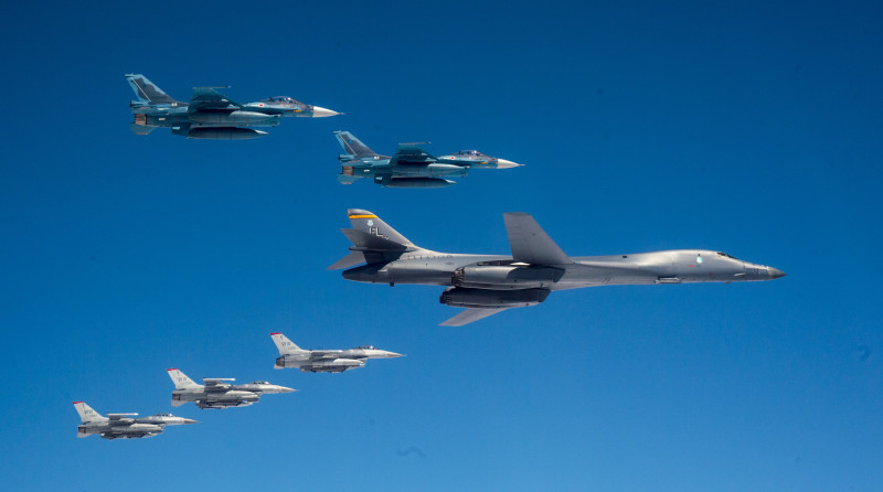 A U.S. Air Force B-1B Lancer bomber and F-16 fighters from Misawa Air Base, Japan, fly with Japan Air Self-Defense Force (JASDF) F-2s off the coast of Northern Japan on April 22, 2020, in a clear warning to China and North Korea of U.S. strategic capabilities. (USAF photo)