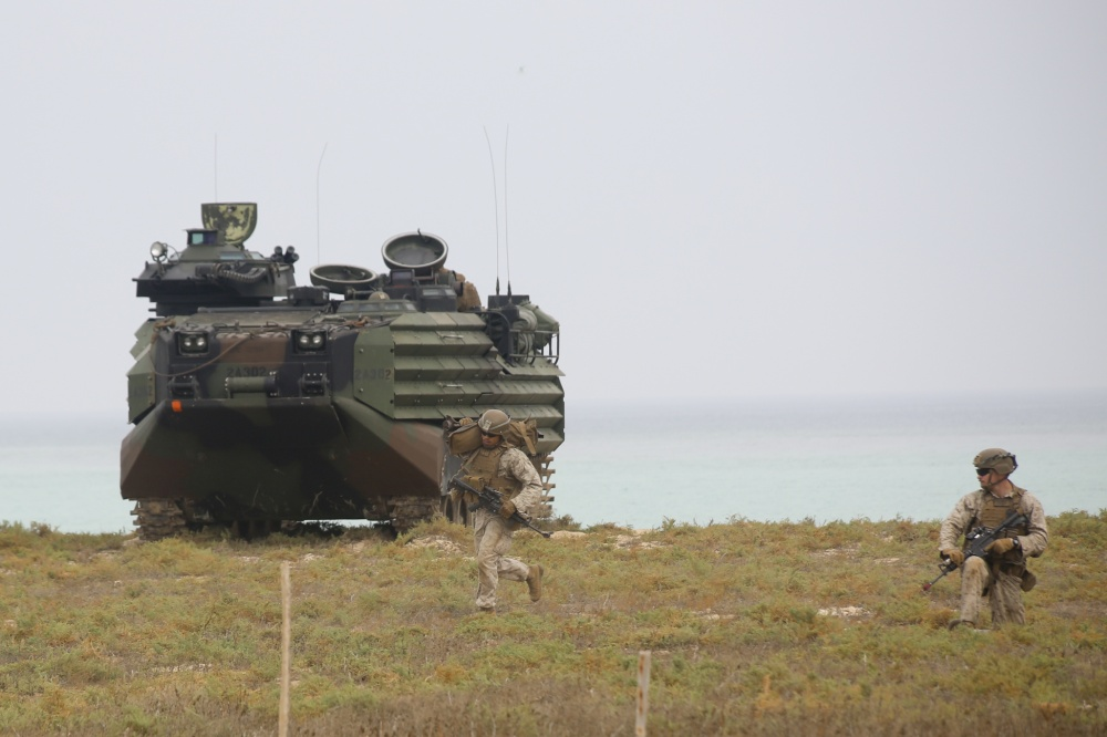 Marines assigned to Golf Company, Battalion Landing Team 2/8, 26th Marine Expeditionary Unit (MEU), conduct an amphibious raid during sustainment training on Karan Island, Saudi Arabia, April 20, 2020. The Bataan Amphibious Ready Group and 26th MEU are conducting routine sustainment training in the U.S. 5th Fleet area of operations in order to enhance the Navy-Marine Corps team's ability to employ low-signature, operationally relevant and strategically mobile crisis response forces to project power over key maritime terrain. (U.S. Marine Corps photo by Staff Sgt. Pablo Morrison)