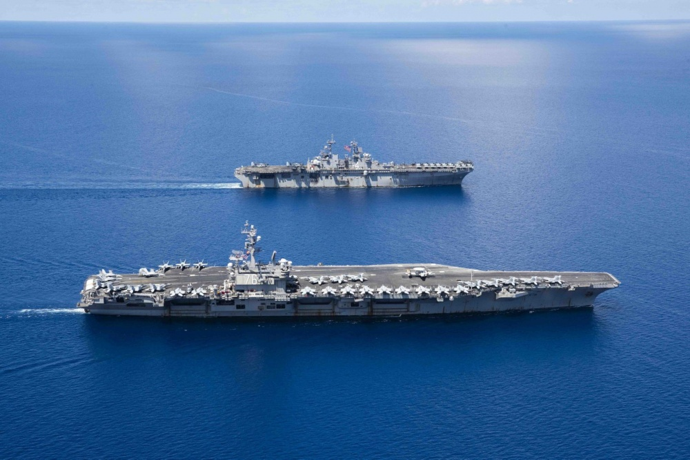 USS Ronald Reagan (CVN 76) and USS Boxer (LHD 6) sail in formation while conducting security and stability operations in the U.S. 7th Fleet area of operations. U.S. 7th Fleet is the largest numbered fleet in the world, and the U.S. Navy has operated in the Indo-Pacific region for more than 70 years, providing credible, ready forces to help preserve peace and prevent conflict. (U.S. Navy photo by Mass Communication Specialist 2nd Class Erwin Jacob V. Miciano)