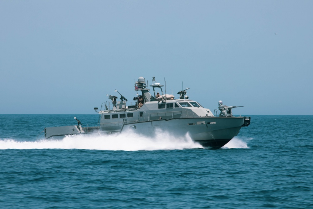 A Mark VI patrol boat participates in the bilateral Mine Countermeasures Exercise 2020 (MCMEX 20) with the mine countermeasures ship USS Gladiator (MCM 11) in the Arabian Gulf, March 28. Gladiator is forward-deployed to the U.S. 5th Fleet area of operations in support of naval operations to ensure maritime stability and security in the Central region, connecting the Mediterranean and the Pacific through the Western Indian Ocean and three strategic choke points. (U.S. Army photo by Pfc. Christopher Cameron)