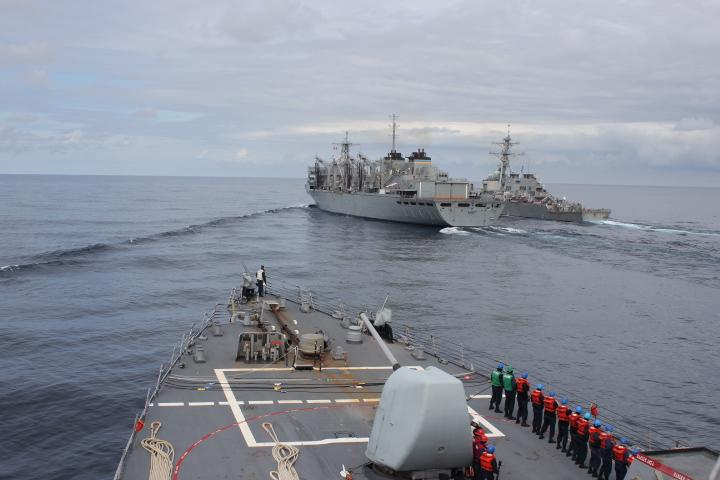 The guided-missile destroyer USS Donald Cook (DDG 75) approaches the fast combat support ship USNS Supply (T-AOE 6) and USS Porter (DDG 78) while operating with the Royal Navy Type 23 frigate HMS Kent (F 78), not pictured, above the Arctic Circle during a bilateral anti-submarine exercise in the North Sea. (U.S. Navy photo Yeoman 3rd Class Anthony Nichols/Released)