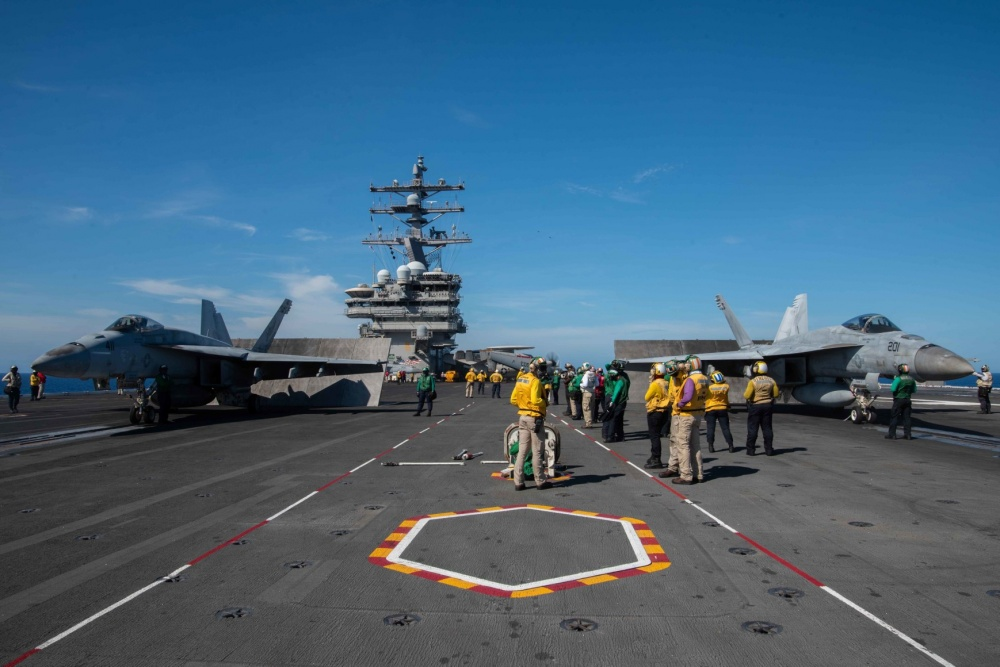 An F/A-18E Super Hornet attached to Strike Fighter Squadron (VFA) 115, left, and an F/A-18E Super Hornet attached to Strike Fighter Squadron (VFA) 27 prepare to launch on the flight deck of the U.S. Navy's only forward-deployed aircraft carrier USS Ronald Reagan (CVN 76). (U.S. Navy photo by Mass Communication Specialist 2nd Class Samantha Jetzer)