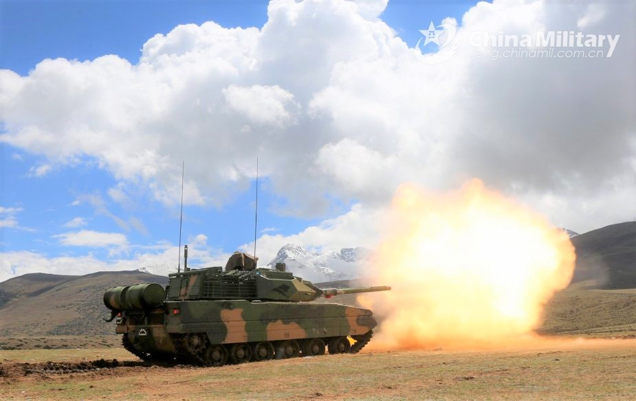 A Type 15 Light Tanks attached to a combined arms brigade under the PLA Xizang Military Command spits fire down range at mock targets during a live-fire training exercise in southwest China's Xizang Autonomous Region from June 8 to 11, 2020. (eng.chinamil.com.cn/Photo by Li Song)