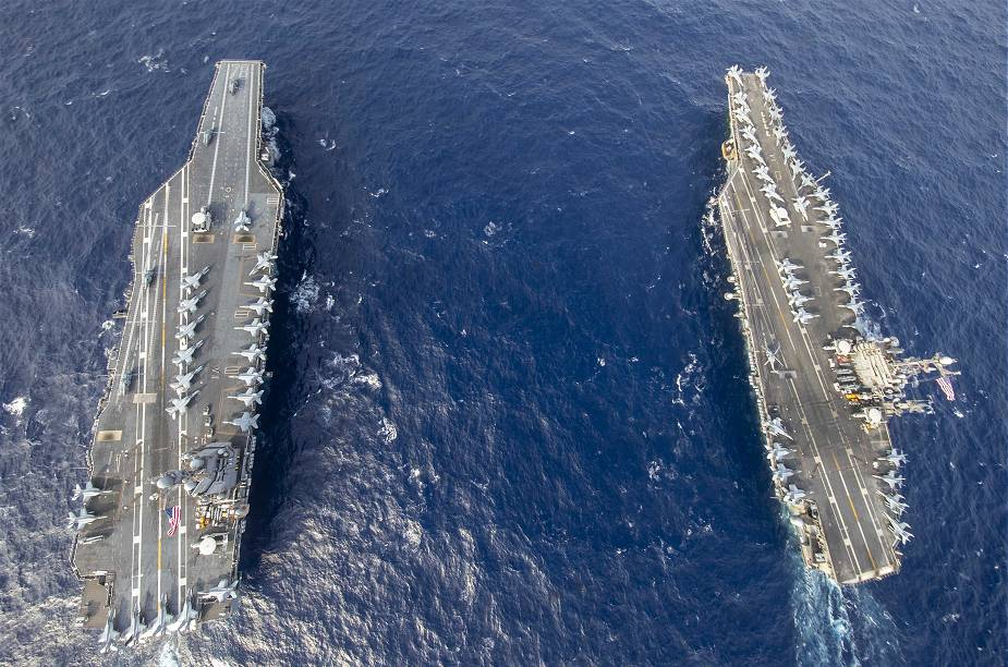 The USS Harry S. Truman CVN 75 Nimitz-Class aircraft carrier operates for the first time at sea with USS Gerald R. Ford (CVN-78) Ford-Class aircraft carrier.