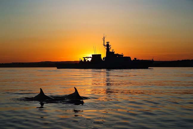 Royal Navy HMS Tamar raises her flag on her own river