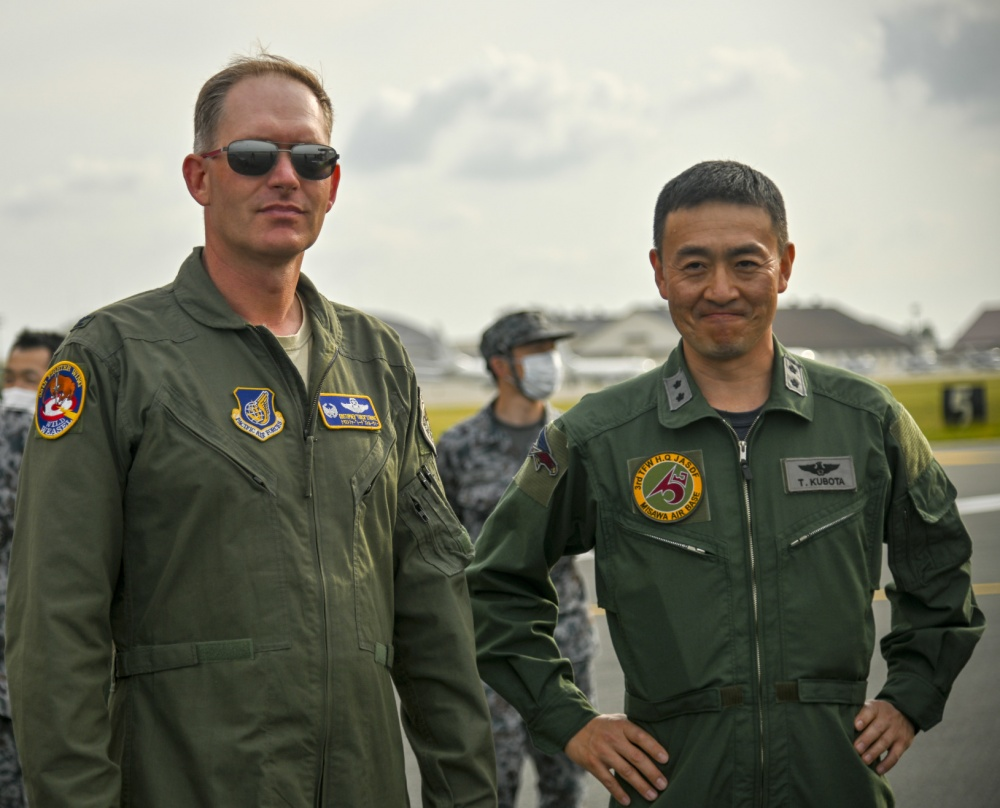 U.S. Air Force Col Kristopher Struve, left, 35th Fighter Wing commander, and Koku-Jieitai Maj. Gen. Takahiro Kubota, 3rd Air Wingcommander, watch as aircraft taxi into position for an