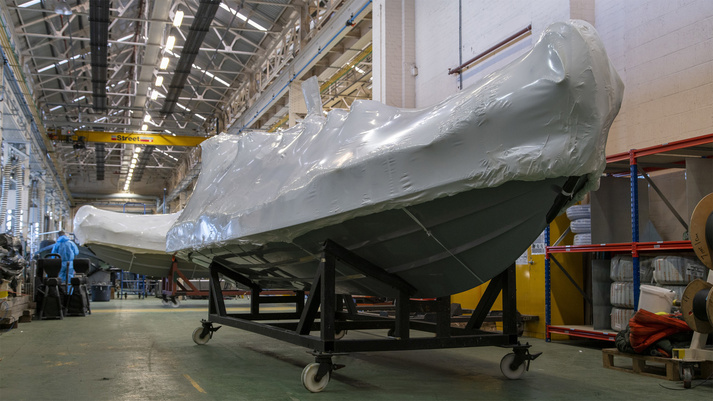 One of six Rigid Inflatable Boats wrapped and ready to leave the Boats factory in Portsmouth, UK.