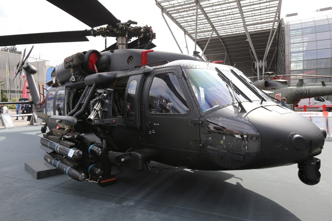 An S-70i Black Hawk helicopter at the MSPO trade show carries a lightweight single-station external stores pylon supporting four Hellfire air-to-ground missiles.