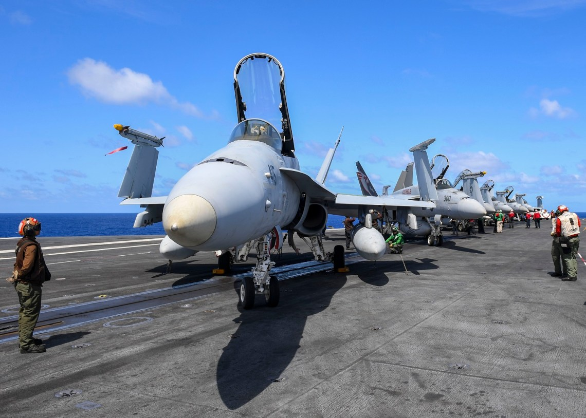 Sailors assigned to the Nimitz Carrier Strike Group perform preflight checks on aircraft aboard the aircraft carrier USS Nimitz (CVN 68). Nimitz, the flagship of Carrier Strike Group 11, is deployed conducting maritime security operations and theater security cooperation efforts. (U.S. Navy photo by Mass Communication Specialist 2nd Class Greg Hall/Released)