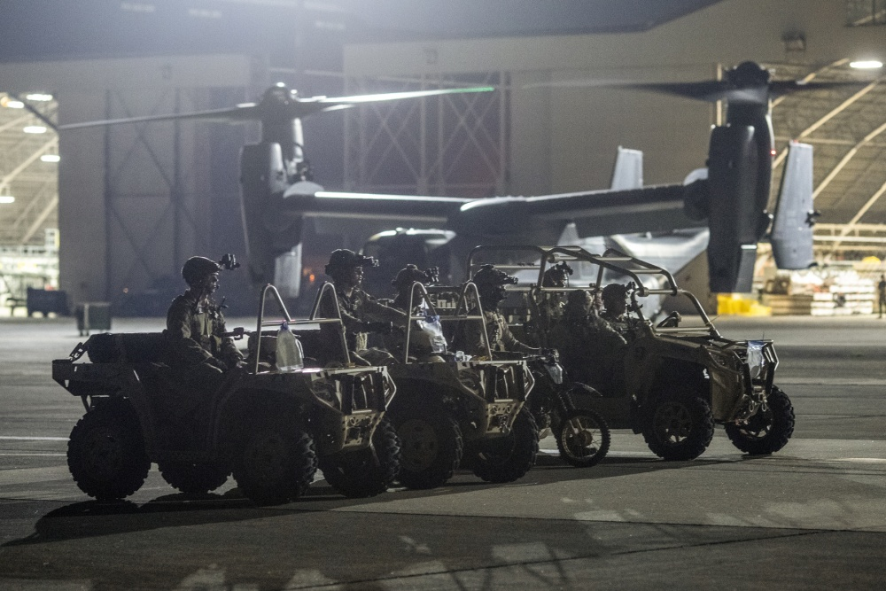Air Force Special Tactics operators with the 320th Special Tactics Squadron out of Kadena Air Base, Japan, wait to load their tactical vehicles into a C-130J Super Hercules during an engine running onload/offload (ERO) training as part of Exercise Gryphon Jet at Yokota Air Base, Japan, June 23, 2020.
