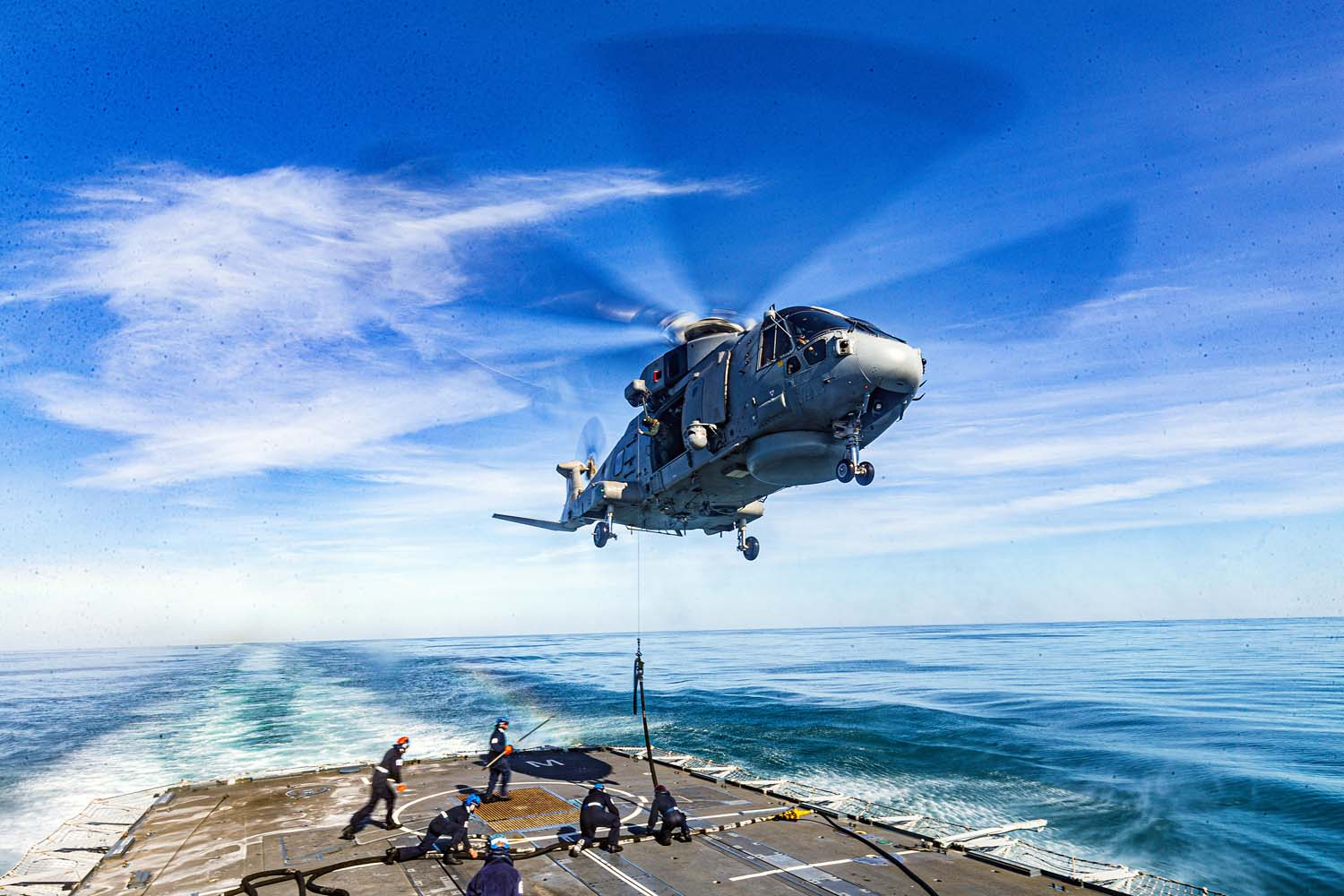 Royal Navy Merlin Helicopter Refuels in Flight from HMS Westminster