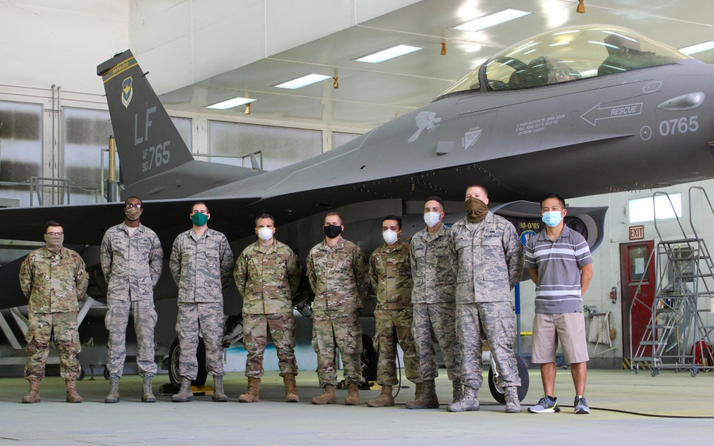 A team of nine 56th Equipment Maintenance Squadron Low Observable Aircraft Structural Maintenance personnel pose for a photo June 27, 2020, at Luke Air Force Base, Ariz.
