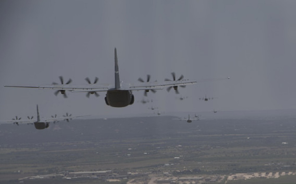 "Multiple C-130J Super Hercules aircraft from the 19th Airlift Wing and 317th AW fly in formation during the Herk Nation Stampede, July 14, 2020. In total, the ""Herk Nation Stampede"" featured a formation flight of 25 aircraft from the 317th AW based at Dyess Air Force Base, Texas and 9 aircraft from the 19th AW based at Little Rock AFB, Arkansas."