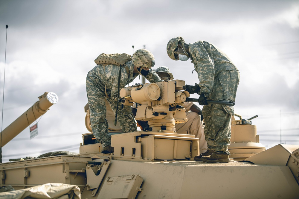 Troopers assigned to Bravo Company, 3rd Battalion, 8th Cavalry Regiment, 3rd Armored Brigade Combat Team (3ABCT), 1st Cavalry Division, conduct preventative maintenance checks and services on their new M1A2C (SEP v.3) Abrams Tanks at Fort Hood, Texas, July 21, 2020.