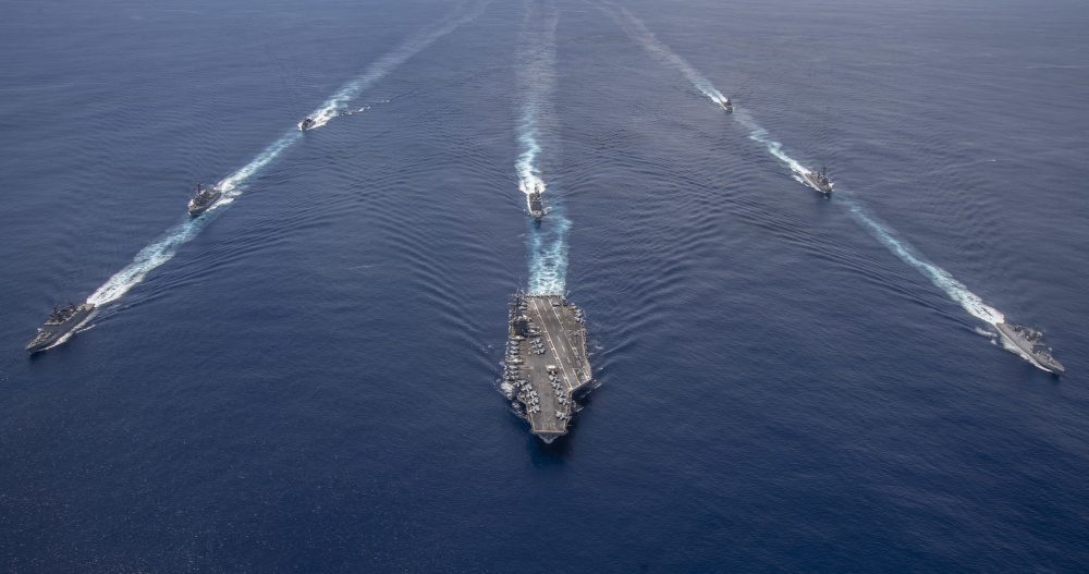 The Nimitz Carrier Strike Group, consisting of flagship USS Nimitz (CVN 68), Ticonderoga-class guided missile cruiser USS Princeton (CG 59), and Arleigh Burke-class guided missile destroyers USS Sterett (DDG 104) and USS Ralph Johnson (DDG 114), along with Indian Navy ships Rana, Sahyadri, Shivalik and Kamorta, steam in formation during a cooperative deployment in the Indian Ocean July 20.
