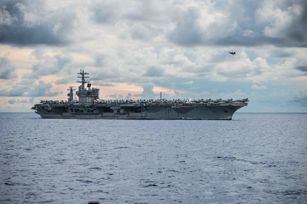 USS Nimitz (CVN 68) steams alongside the Navy's only forward-deployed aircraft carrier USS Ronald Reagan (CVN 76). Nimitz and Ronald Reagan Carrier Strike Groups are conducting dual-carrier as the Nimitz Carrier Strike Force.