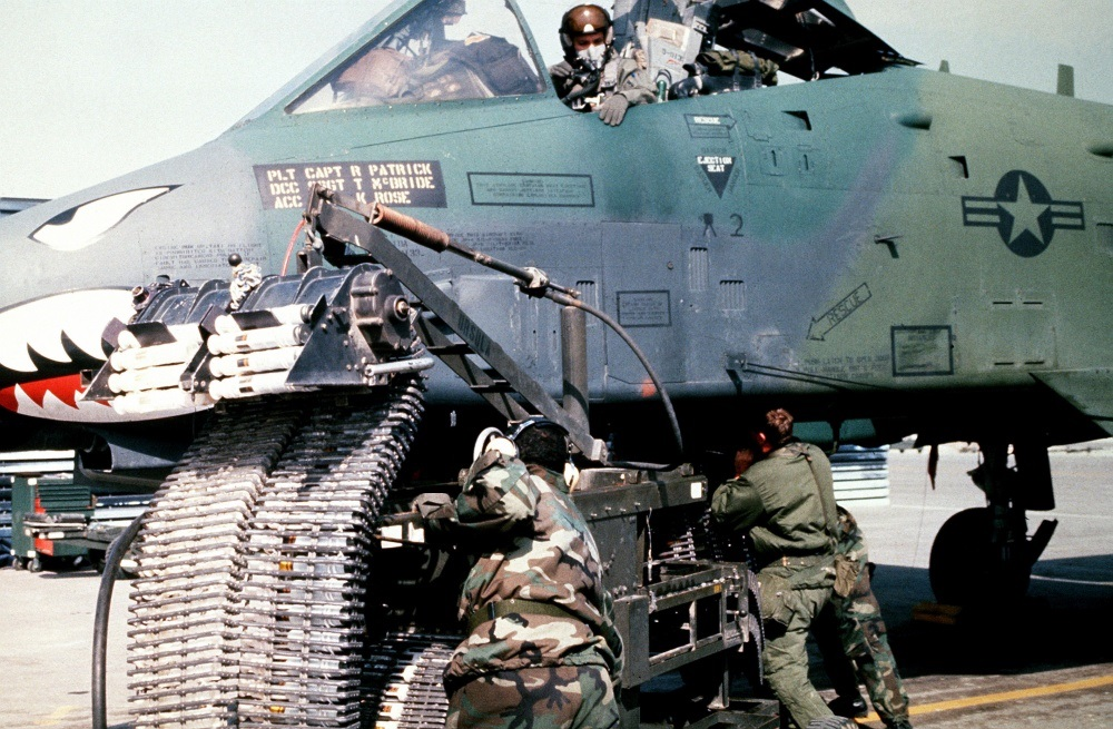 Munitions specialists from the 23rd Tactical Fighter Wing, England Air Force Base, La., load 30 mm rounds of ammunition into an A-10A Thunderbolt II attack aircraft for its GAU-8/A Avenger cannon prior to a sortie in support of Operation Desert Storm.