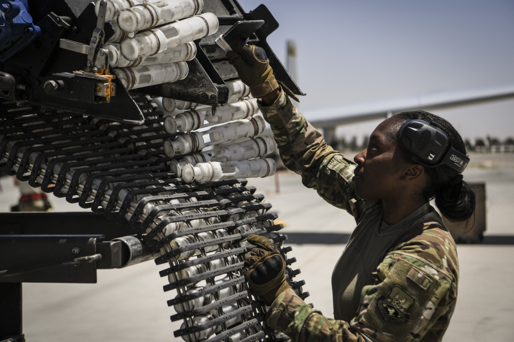 U.S. Air Force Staff Sgt. Sharane Watson reloads the General Electric GAU/8 Avenger 30mm hydraulically driven seven-barrel autocannon of an A-10 Thunderbolt II at Kandahar Airfield, Afghanistan.