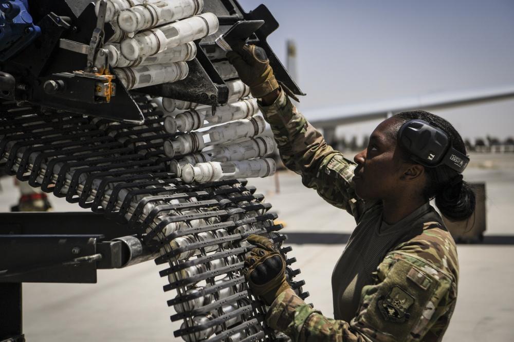 U.S. Air Force Staff Sgt. Sharane Watson reloads the General Electric GAU/8 Avenger 30mm hydraulically driven seven-barrel autocannon of an A-10 Thunderbolt II at Kandahar Airfield, Afghanistan.