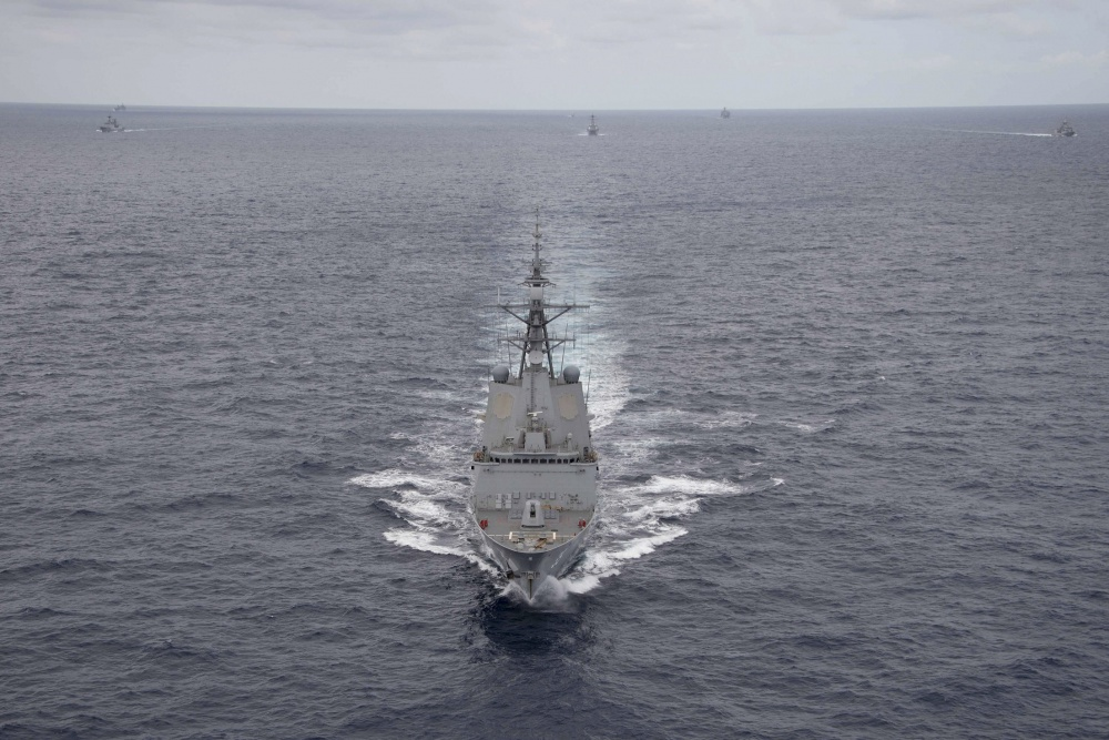 Royal Australian Navy ship HMAS Hobart (DDG 39) steams in a multinational formation during a photo exercise off the coast of Hawaii during the Rim of the Pacific (RIMPAC) exercise.