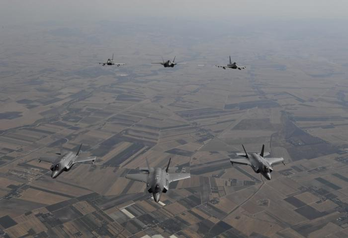 U.S. Air Force F-35A Lightning II aircraft conduct bilateral training with Italian air force F-35s over Italy,