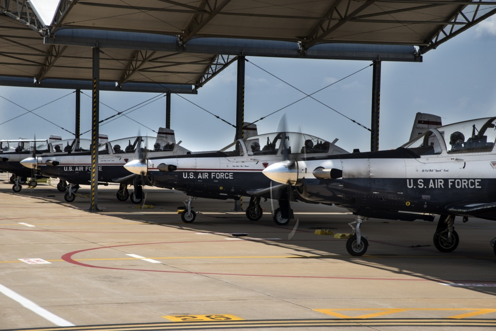 Vance pilots prepare a T-6 Texan II for a training flight June 13, 2018, at Vance Air Force Base, Oklahoma. The T-6 Texan II is the first aircraft Air Force Pilots learn to fly before moving on to more advanced aircraft.