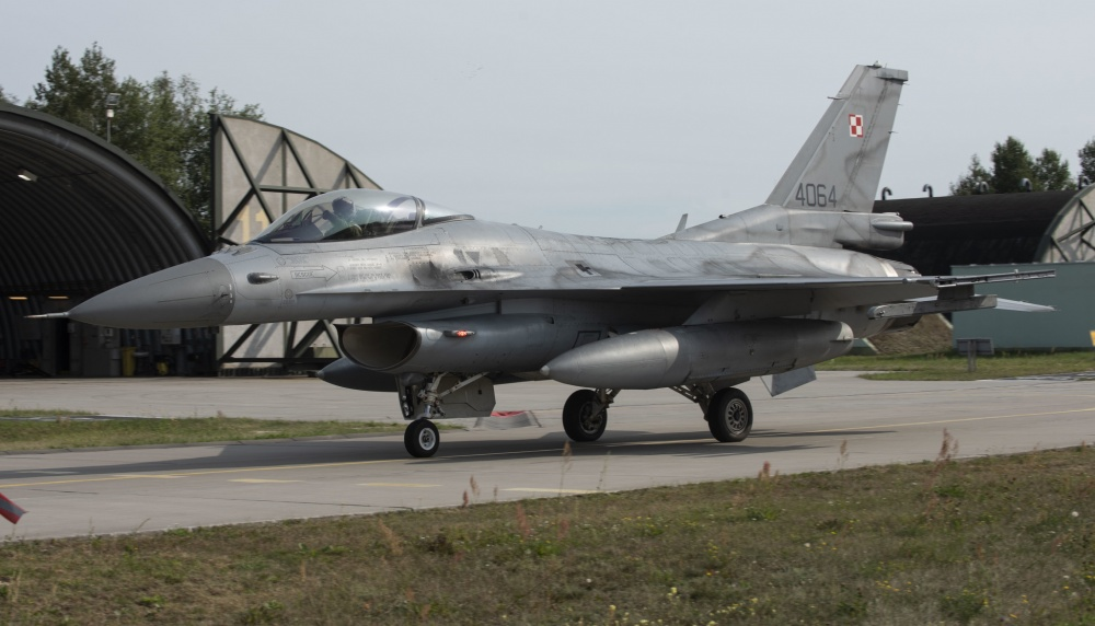 A Polish air force F-16, assigned to the 32nd Tactical Air Base, taxis out of a hangar at Łask AB, Poland, August 19, 2020.