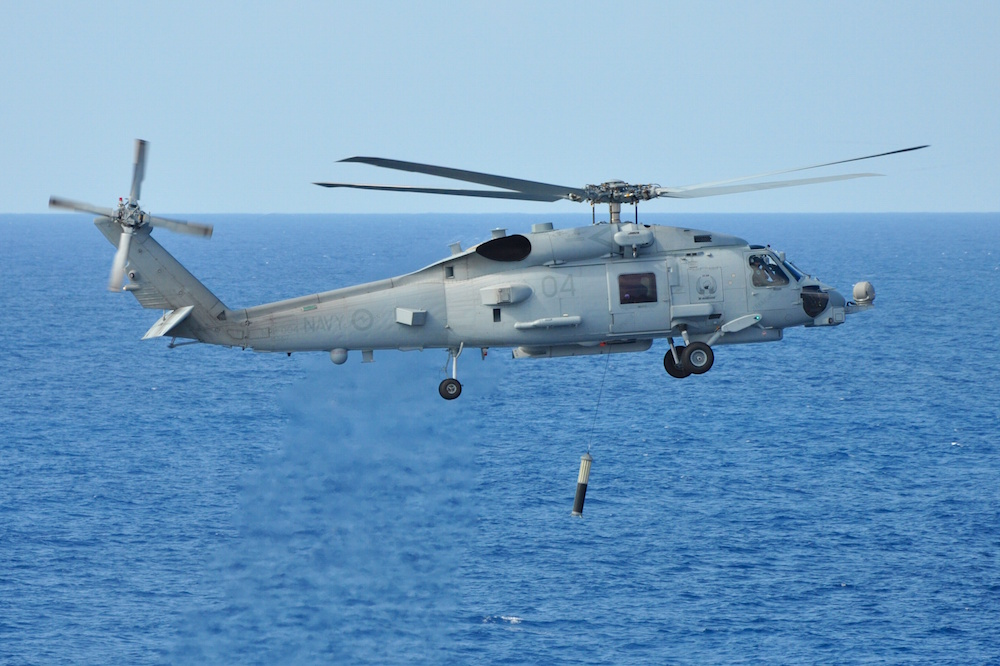 The Royal Australian Navy's MH-60R Romeo helicopter conducts functional testing of the newly fitted Airborne Low Frequency Sonar System (ALFS) off the coast of Jacksonville, Florida.