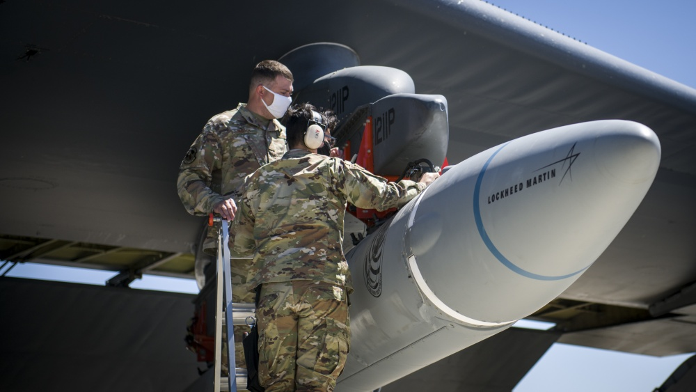 Master Sgt. John Malloy and Staff Sgt. Jacob Puente, both from 912th Aircraft Maintenance Squadron, secure the AGM-183A Air-launched Rapid Response Weapon Instrumented Measurement Vehicle 2 as it is loaded under the wing of a B-52H Stratofortress at Edwards Air Force Base, California, Aug. 6.