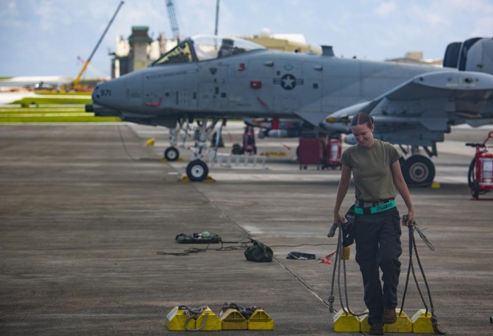 U.S. Air Force Airman 1st Class Cheyenne Loew, assigned to the 25th Aircraft Maintenance Unit (AMU), Osan Air Base (OAB), South Korea, prepares to receive an A-10 Thunderbolt II at Andersen Air Force Base, Guam, Aug. 17, 2020.