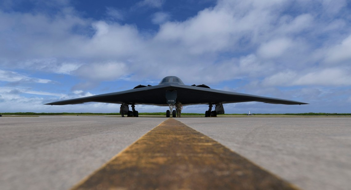U.S. Air Force Senior Airman Robert Witkowski and Staff Sgt. Mark Farrar, 393rd Expeditionary Bomb Squadron crew chiefs, deployed from Whiteman Air Force Base, Missouri, prepare a B-2 Spirit Stealth Bomber for take-off at Naval Support Facility Diego Garcia, to support a Bomber Task Force mission, Aug. 17, 2020.