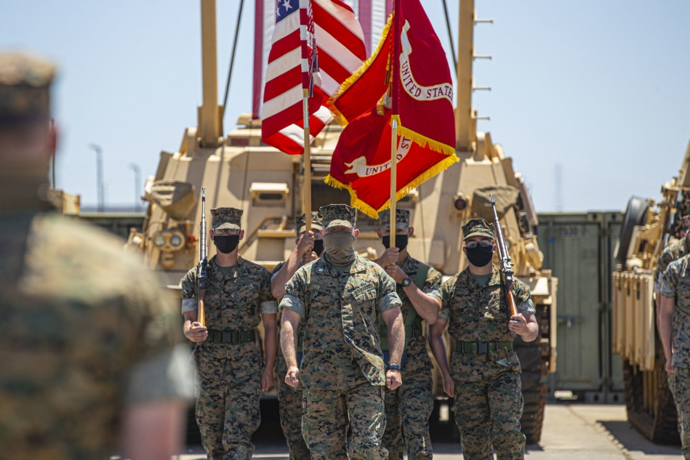 Alpha Company, 4th Tank Battalion, 4th Marine Division, Marine Forces Reserve, marches forward with the color guard during the company's deactivation ceremony in 41 Area on Marine Corps Base Camp Pendleton, California.