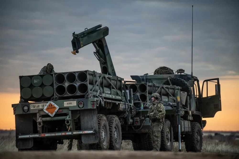 """Soldiers of the 1st Battalion, """"The Steel Warrior Battalion,"""", 14th Field Artillery Regiment, 75th Field Artillery Brigade, Fort Sill, Okla., prepare to unload rocket pods for a M142 High Mobility Artillery Rocket System (HIMARS) on February 14, 2020 during a field training exercise on Fort Sill."""