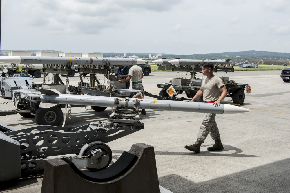 Maintainers loaded AIM-9 sidewinder missiles, AIM-120 advanced medium-range air-to-air missiles, flares, and M-61A1 cannon rounds onto F-15 Eagles, before the aircraft taxied and were dispersed around the flight line.