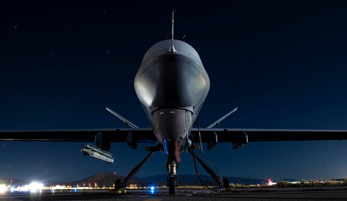 A U.S. Air Force MQ-9 Reaper assigned to the 556th Test and Evaluation Squadron armed with an AIM-9X missile sits on the ramp on September 3, 2020 ahead of the ABMS Onramp #2.