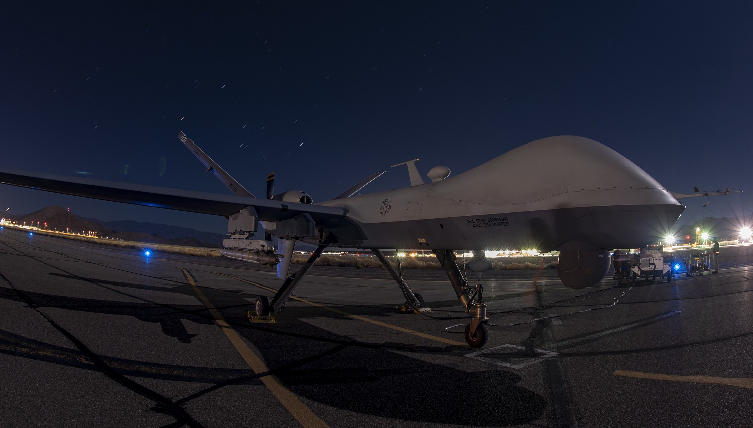 US Air Force MQ-9 Reaper UAV Fires AIM-9X Air-to-Air Missile