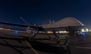 US Air Force MQ-9 Reaper UAV Fires AIM-9X Air-to-Air Missile