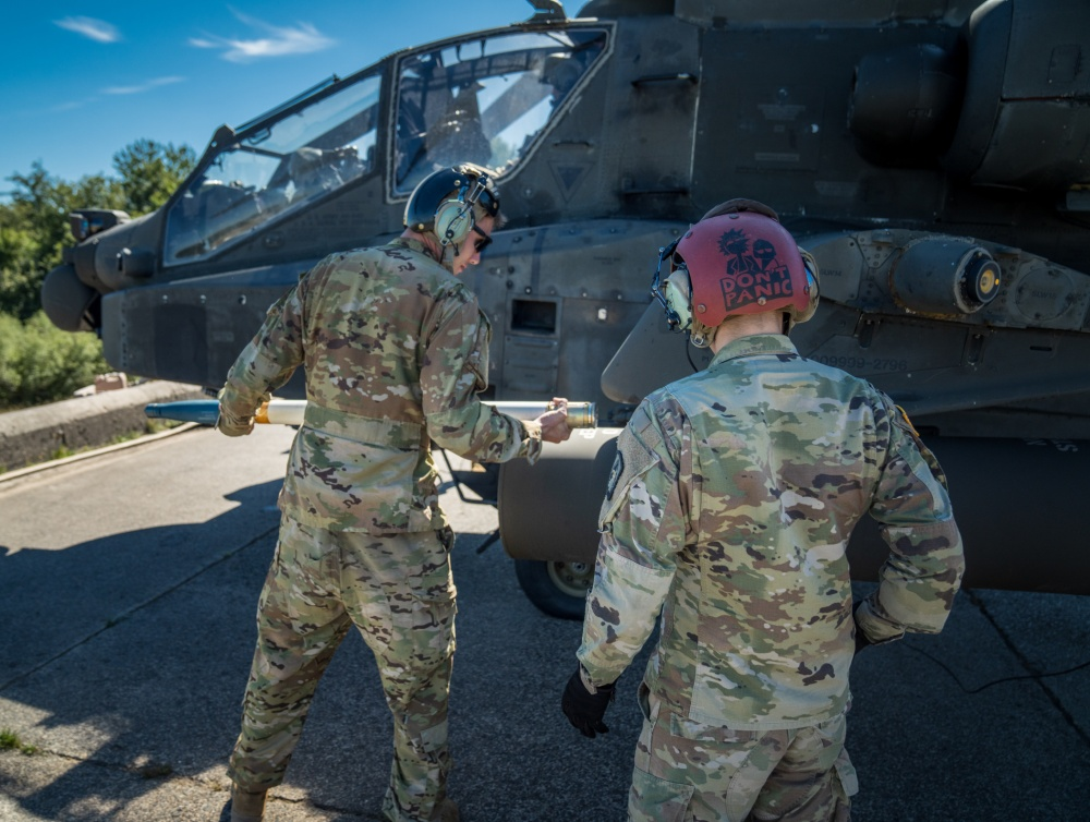 U.S. Army Spc. Jonathan Castrechino and Spc. Sean Seksinsky load rockets into an AH-64 Apache from A Co, 1-3 Attack Reconnaissance Battalion on Sep. 8 at Baumholder Training Area, Germany.