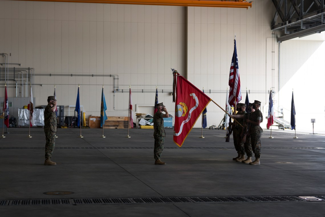 U.S. Marines with Marine All Weather Fighter Attack Squadron (VMFA(AW)) 242 present colors during the change of command and re-designation of VMFA(AW)-242 at Marine Corps Air Station Iwakuni, Japan, Oct. 16, 2020. U.S. Marine Corps Lt. Col. Andrew Kelemen, outgoing commanding officer of VMFA(AW)-242, relinquished command to Lt. Col. Michael Wyrsch during the re-designation and change of command of VMFA(AW)-242 to Marine Fighter Attack Squadron (VMFA) 242. VMFA-242's transition to the F-35B Lightning II brings advanced avionics capabilities to joint, allied, and partner forces in support of the U.S.-Japan Alliance and a free and open Indo-Pacific. (U.S. Marine Corps photo by Lance Cpl. Tyler Harmon)
