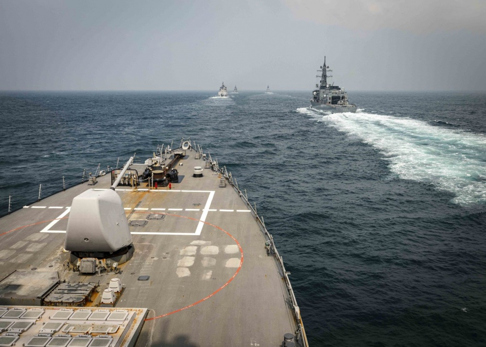 The Arleigh Burke-class guided-missile destroyer USS John S. McCain (DDG 56) sails in formation with ships from the Indian Navy, Royal Australian Navy, and Japan Maritime Self-Defense Force while conducting replenishment-at-sea approaches (RASAPs) as part of Malabar 2020. (U.S. Navy photo by Mass Communication Specialist 2nd Class Markus Castaneda/Released)